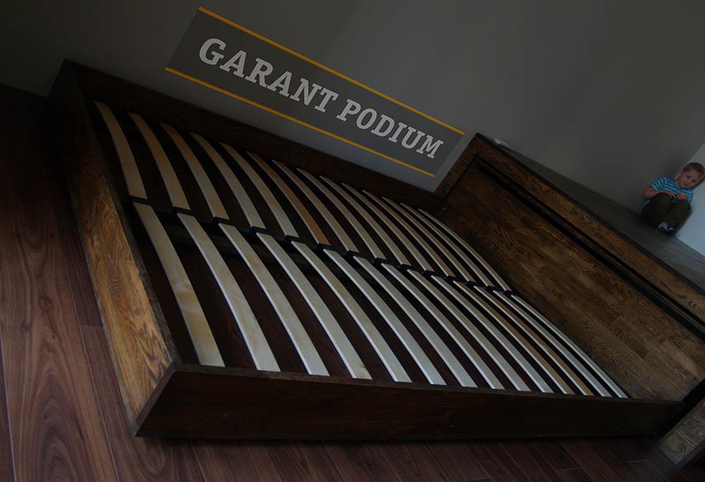 Подиум с выкатной кроватью и ящиками